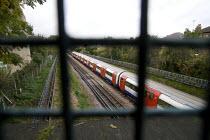 A Northern Line Train passing under a bridge. - Duncan Phillips - 15-10-2008