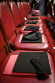 Mortarboards placed on chairs at a university graduation day at The Guildhall, London - Duncan Phillips - 02-12-2010