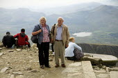 Elderly couple at the summit of Mount Snowdon, North Wales. - Duncan Phillips - 03-08-2011