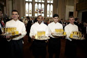 Catering staff serving drinks at the Guildhall, London Wine on trays. - Duncan Phillips - 2000s,2009,alcohol,BAME,BAMEs,banquet,banqueting,Black,BME,bmes,cater,caterer,caterers,catering,champagne,CHAMPAIGN,cities,city,dinner,dinners,diversity,drink,drinking,drinks,EARNINGS,EBF,Economic,Eco
