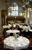 Catering staff preparing for a banquet at the Guildhall, London. Being instructed - Duncan Phillips - 2000s,2009,banquet,banqueting,cater,caterer,caterers,catering,cities,city,dinner,dinners,drink,EARNINGS,EBF,Economic,Economy,employee,employees,Employment,EQUALITY,feast,food,FOODS,guildhall,hall,hosp