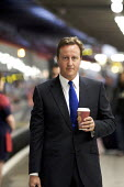 David Cameron MP with cup of Coffee before departing on a train from Euston Station, London - Duncan Phillips - 08-09-2008