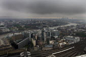 Gloomy weather over the City of London financial district - Duncan Phillips - 2000s,2008,adult,adults,bank,banking,banks,BUILDING,buildings,carriage,carriages,cities,city,cityscape,cityscapes,cloud,clouds,cloudy,COMMUTE,commuter,commuters,commuting,conditions,construction,EBF,E