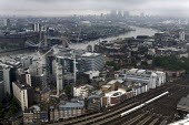 Gloomy weather over the City of London financial district - Duncan Phillips - ,2000s,2008,adult,adults,bank,BANKS,BUILDING,buildings,carriage,carriages,cities,city,cityscape,cityscapes,COMMUTE,commuter,commuters,commuting,conditions,construction,EBF Economy,employee,employees,E