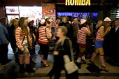 "Hen Party dressed up as ""where's Wally"" character, fancy dress outside the Rumba Club and Bar, West End, London - Duncan Phillips - 2010s,2012,Birthday Party,central,cities,city,club,clubbers,clubbing,clubs,dress,Hen,holiday,holiday maker,holiday makers,holidaymaker,holidaymakers,holidays,Leisure,LFL,life,london,maker,makers,night"