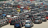 New French cars lined up ready for export, Calais, France. - Duncan Phillips - 2000s,2007,auto,AUTOMOBILE,AUTOMOBILES,automotive,automotive industry,calais,capitalism,capitalist,car,Car Industry,carindustry,cars,citroen,dock,docks,EBF Economy,eu,Europe,european,europeans,export,