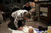 Father looking after baby at home. - Duncan Phillips - 15-07-2005