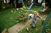 Family working and playing in their garden. - Duncan Phillips - 15-07-2005