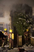 Firefighters with breathing apparatus attend a house Fire, Barnet, London - Duncan Phillips - 07-01-2010