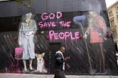 God save the people, street art with Quenn Elizabeth holding a can of pink paint and a paint brush, corgi dog and a Guardsman in a Bearskin hat, central London Thierry Guetta - Duncan Phillips - 14-06-2012