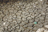 Cracked mud on dried up lake - Duncan Phillips - 2000s,2009,country,countryside,cracked,Dried Up,drought,dry,eni,environment,Environmental degradation,Environmental Issues,eu,Europe,european,europeans,eurozone,france,french,habitat,lakebed,landscape
