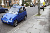 A G-Wiz Electric car being charged by the curbside, London - Duncan Phillips - 10-03-2012