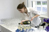 Catering staff pouring Champagne - Duncan Phillips - 2000s,2006,alcohol,catering,champagne,CHAMPAIGN,cities,city,drink,EARNINGS,ebf,Economic,economy,EQUALITY,FEMALE,glass,glasses,hospitality,Income,INCOMES,inequality,job,jobs,LAB LBR Work,living wage,Lo