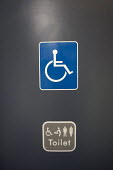 Disabled sign on train toilet - Duncan Phillips - 2000s,2006,access,bound,communicating,communication,disabilities,disability,disable,disabled,disablement,incapacity,journey,journeys,minorities,mobility,needs,network,people,ramp,sign,signs,social,spe