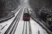 Northern line train in the snow, London - Duncan Phillips - 2010,2010s,adult,adults,carriage,carriages,cities,city,CLIMATE,cold,commute,commuter,commuters,commuting,conditions,driver,drivers,driving,EBF,Economic,Economy,from work,frozen,ice,journey,journey to,