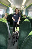 Guide dog and partially sighted woman travelling on an overground train - Duncan Phillips - 29-01-2008
