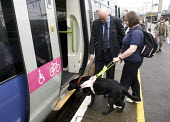 Blind woman with guide dog boarding a train - Duncan Phillips - 29-01-2008