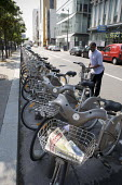 Velib bicycle hire scheme, Paris, France. Ten thousand bicycles were introduced to the city with 750 automated rental stations each with fifteen or more bikes and spaces. This number has since grown t... - Duncan Phillips - 29-06-2010