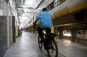 Eurostar Engineering Centre, Temple Mills, London - Duncan Phillips - 2000s,2008,adult,adults,bicycle,bicycles,BICYCLING,Bicyclist,Bicyclists,BIKE,BIKES,BME Black minority ethnic,cities,city,COMMUTE,commuter,commuters,commuting,cycle,cycles,cycling,Cyclist,Cyclists,depo