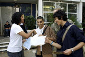 6th Form students opening their A Level results. - Duncan Phillips - 2000s,2007,A Level,A Level,adolescence,adolescent,adolescents,alevel,alevels,BME Black minority ethnic,CELEBRATE,celebrating,celebration,CELEBRATIONS,college,COLLEGES,congratulating,congratulations,Ed