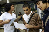 6th Form students opening their A Level results. - Duncan Phillips - 2000s,2007,A Level,A Level,adolescence,adolescent,adolescents,alevel,alevels,BME Black minority ethnic,college,COLLEGES,Edu education,education,exam,examination,examinations,examining,exams,FE,Further