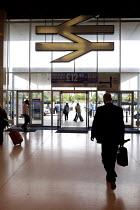Milton Keynes Train Station. - Duncan Phillips - 2000s,2007,adult,adults,commute,commuter,commuters,commuting,EBF Economy,entrance,exit,from work,journey,journey to,journeys,lfl,LIFE,lifestyle,MATURE,network,PASSENGER,passengers,people,person,rail,r