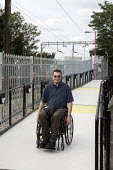 Wheelchair user gaining access to a railway station. - Duncan Phillips - 06-09-2007