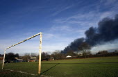 Plume of black smoke from the fire at Buncefield oil depot fire above a school playing field. - Duncan Phillips - 13-12-2005
