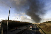 M1 Motorway with Plume of black smoke from the fire at Buncefield oil depot fire - Duncan Phillips - 13-12-2005