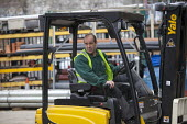 Fork lift driver at Builders supply Yard, London - Duncan Phillips - 14-05-2013