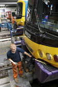 Mechanic working in train maintenance depot - Duncan Phillips - ,2000s,2007,carriage,carriages,depot,DEPOTS,EBF Economy,engineer,engineers,LAB LBR Work,locomotive,LOCOMOTIVES,maintaining,maintenance,male,man,mechanic,MECHANICS,men,network,people,person,persons,RAI
