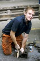 Mechanic working in train maintenance depot - Duncan Phillips - ,2000s,2007,depot,DEPOTS,EBF Economy,engineer,engineers,LAB LBR Work,maintaining,maintenance,male,man,mechanic,MECHANICS,men,network,people,person,persons,RAIL,railway,RAILWAYS,REFURBISHED,REFURBISHIN