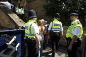 Railway enforcement officers and British Transport Police implementing a ticket blockade Plumbstead, London - Duncan Phillips - 18-05-2007