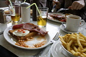 Traditional fried English breakfast - Duncan Phillips - 2010,2010s,bacon,beans,breakfast,cafe,cafes,catering,diet,diets,eat,eating,EBF,Economic,Economy,egg,eggs,English,fish,fishes,food,FOODS,fried,health,outlet,outlets,restaurant,restaurants,sausage,sausa