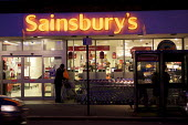 Sainsbury's supermarket, London - Duncan Phillips - 2010s,2011,at,bought,buy,buyer,buyers,buying,commerce,commodities,commodity,consumer,consumers,customer,customers,EBF Economy,food,FOODS,goods,LFL,LIFE,London,night,outlet,outlets,PEOPLE,purchase,purc