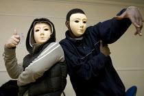 Student actors wearing multicultural masks - Duncan Phillips - 15-11-2005