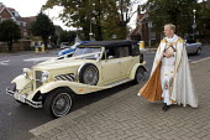 Brides Wedding car arriving at church. - Duncan Phillips - ,&,2000s,2006,ARRIVAL,arrivals,arrive,arrived,arrives,arriving,AUTO,AUTOMOBILE,AUTOMOBILES,AUTOMOTIVE,belief,bride,car,cars,catholic,catholicism,CELEBRATE,CELEBRATING,celebration,CELEBRATIONS,christia