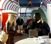 Passenger buying a ticket Waterloo East Station - Duncan Phillips - 26-10-2004