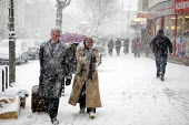 Severe cold weather brings disruption as heavy snow falls in London. - Duncan Phillips - 2010,2010s,adult,adults,cities,city,CLIMATE,cold,COMMUTE,commuter,commuters,commuting,conditions,disruption,freezing,from work,frozen,heavy,holiday,holiday maker,holiday makers,holidaymaker,holidaymak