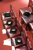 Mortarboards placed on chairs at a university graduation day at The Guildhall, London - Duncan Phillips - 18-05-2010
