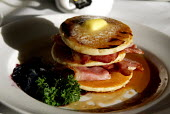 Pancake, butter and bacon breakfast in a dinning car on a train. - Duncan Phillips - 19-01-2006