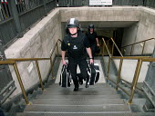 Police in protective clothing attend Bank station which was evacuated in the rush hour due to a security alert. - Duncan Phillips - 15-07-2005