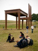 People admiring The writer by Giancarlo Neri. A griant table and chair, Hampstead Heath London. Giancarlo Neri chose the heath, one of most popular parks, after hearing of its artistic heritage. The N... - Duncan Phillips - 17-04-2005