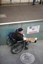 Homeless man begging by the Millennium Bridge, London. Sign says homeless no benefits - Duncan Phillips - 2010,2010s,baggar,beg,beggar,beggars,BEGGER,begging,begs,benefit,benefits,bound,Bridge,cities,city,communicating,communication,destitute,disabilities,disability,disable,disabled,disablement,homeless,h