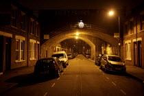 Night time Street scene, Hackney, London - Duncan Phillips - 2000s,2007,at,bridge,cities,city,CLJ,Hackney,highway,housing,London,night,night time,nighttime,RAIL,railway,RAILWAYS,road,roads,safety,scene,scenes,street,streets,TERRACE,Terraced,Terraces,time,urban