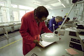 Disabled workers at a Remploy Factory, London - Duncan Phillips - ,2000s,2005,BME Black minority ethnic,capitalism,capitalist,cities,city,disabilities,disability,disable,disabled,disablement,EBF Economy,ELECTRONIC,electronics,FACTORIES,factory,incapacity,Industries,