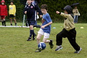 Pupils playing a football match - Duncan Phillips - 2000s,2008,activity,adolescence,adolescent,adolescents,ball,balls,boy,boys,child,CHILDHOOD,children,COMPETITATIVE,competition,edu,educate,educating,education,educational,EXERCISE,exercises,exercising,