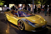 Chrome gold Ferrari 458 Spider supercar parked outside Harrods, Kensington, London. Owned by Kick boxing champion Iraqi Riyadh Al Azzawi - Duncan Phillips - 04-08-2015