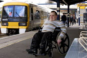 Disabled persons using the railways. - Duncan Phillips - 2000s,2008,Access,bound,carriage,carriages,cities,city,disabilities,disability,disable,disabled,disablement,embarking,getting,incapacity,infrastructure,journey,journeys,london,male,man,men,minorities,