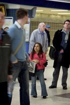 Disabled persons using the railways. - Duncan Phillips - 2000s,2008,Access,Achondroplasia,cities,city,disabilities,DISABILITY,disable,disabled,disablement,dwarf,dwarfism,dwarfs,FEMALE,height,incapacity,journey,journeys,london,midget,midgets,minorities,needs